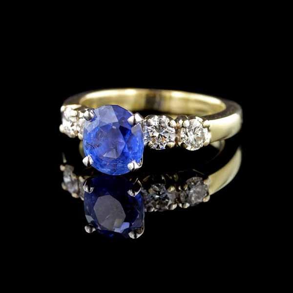 14K White Gold Sapphire and 4 Diamond Ring