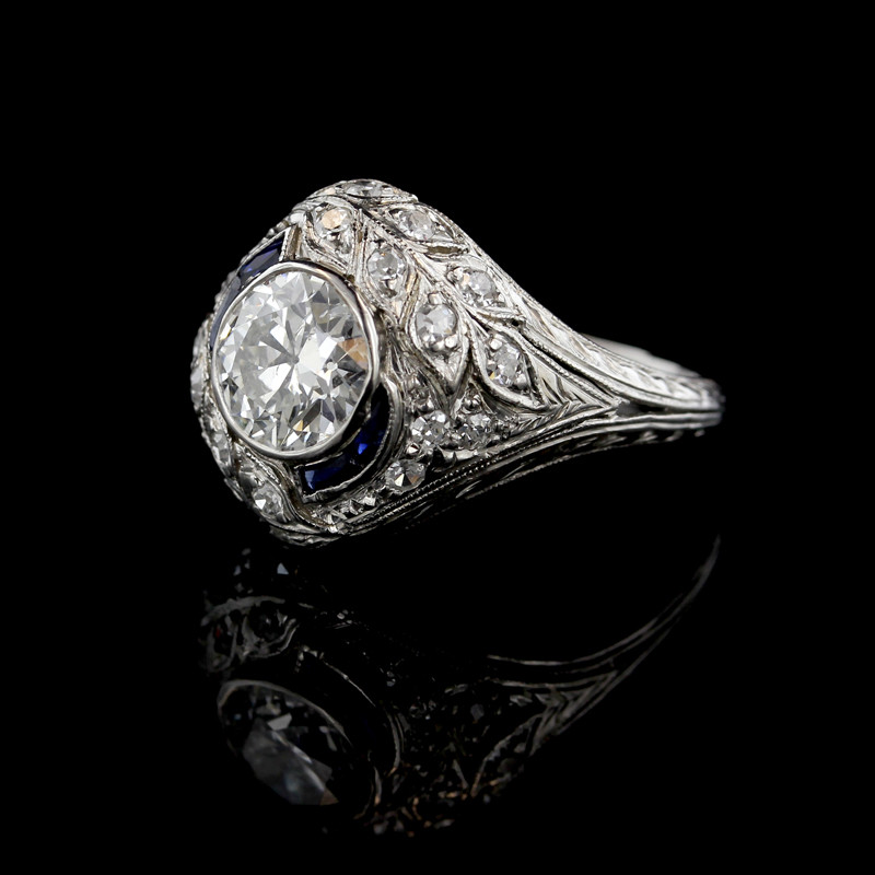 Art_Deco_Platinum_Diamond_and_Synthetic_Sapphire_Ring.jpeg