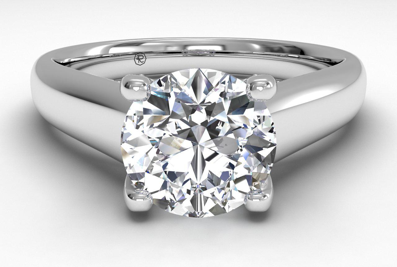SOLITAIRE DIAMOND ENGAGEMENT RING WITH PAVÉ TULIP DETAIL Platnium