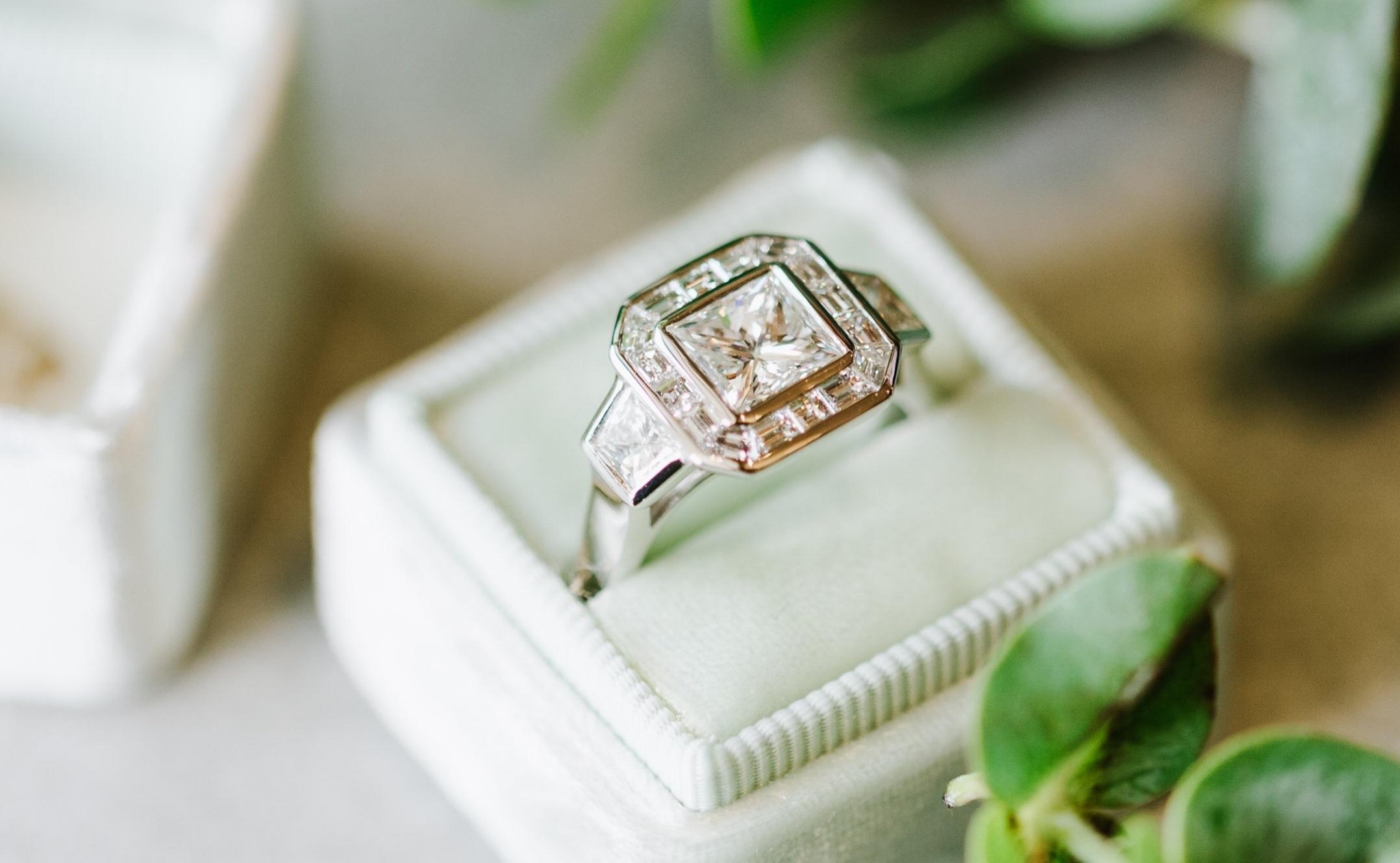 Add a diamond halo around the center diamond