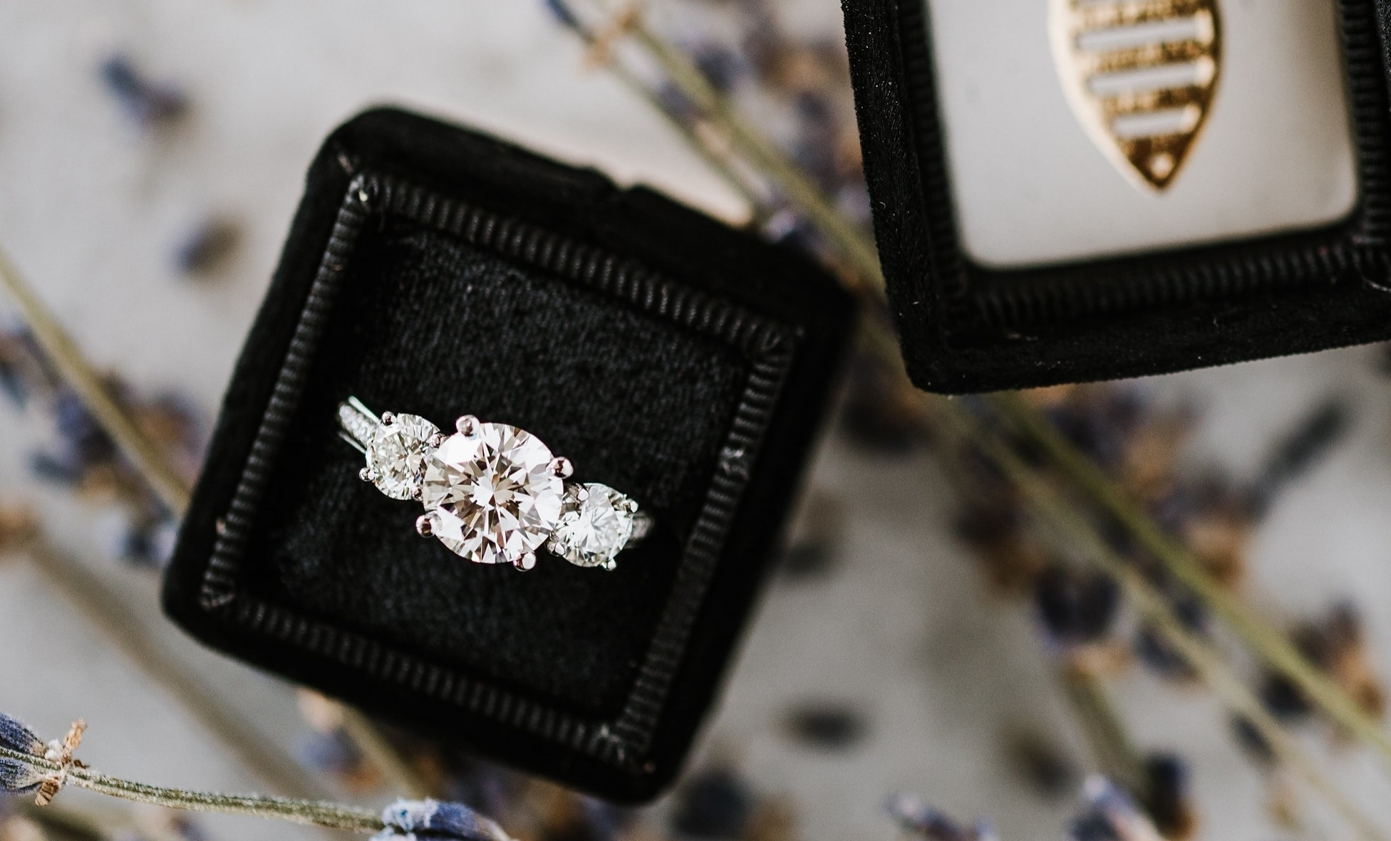 Make it a three-stone ring with smaller diamonds instead of one large solitaire diamond