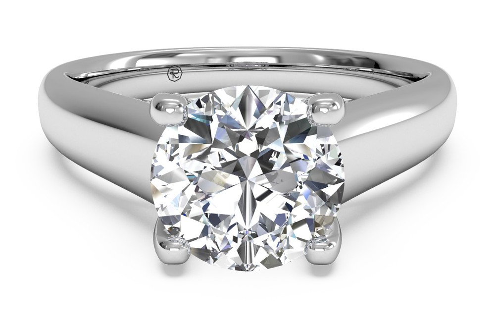 SOLITAIRE DIAMOND ENGAGEMENT RING WITH PAVÉ TULIP DETAIL White Gold